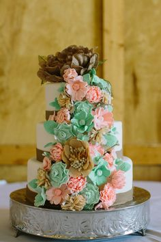 Rustic pink, mint, and burlap floral wedding cake Photo by Laurelyn Savannah Photography)