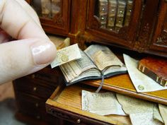 EV Miniatures: Gold wax seals on old aged documents.