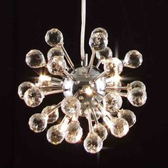Give any space a modern update with this six-light crystal chandelier. With 100 percent crystal balls that capture and reflect the light, this chandelier has a chrome center and a contemporary style that will become the centerpiece of your room.