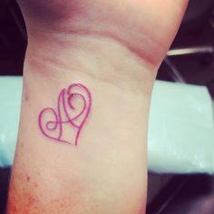 Heart initial tattoo