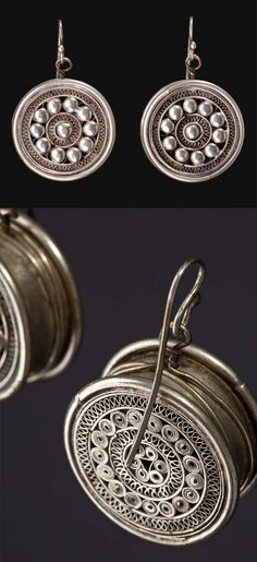 China | The discs, constituting the earrings, are decorated with concentric circles of small spheres and watermark. They are worn by the Ethnic Chinese Dong living in the South East of China | ca. first half of the 20th century.