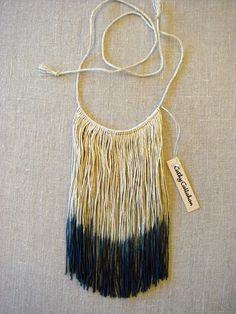 """Sustainably raised hemp yarn ombre dyed. Natural at the neckline and gray at the tips. Fringe is 8"""" in length and the hand turned neck cord is 40"""" ..."""
