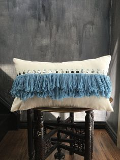 Inspired from everything Moroccan, this gorgeous pillow has beautiful details...  • Natural cotton twill base  • Embroidered with a light blue fringe, embroidered details and silver metal paillettes  • Natural cotton twill backing  • Dry clean only  • Brand new  • Fits a 12 x 20 insert (pillow cover measures 11 X 19) *insert NOT included*  • Bottom zip  • FREE SHIPPING to U.S.A & CANADA (tracking number provided)  • FREE INTERNATIONAL SHIPPING (with a minimum purchase of 3 pillows; tracking…