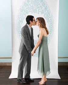 Create your own photo booth with an oversize canvas backdrop. Create a design and take it to a copy center that can print the large file (we went to FedEx Office). What should our backdrop be???
