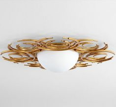 A work of functional art, this ceiling mount features swirling, sculptural adornments in gold-leaf with an opal-white glass enclosure. Transitional Ceiling Lighting, Cyan, Rustic Wall Sconces, Glass Diffuser, Gold Leaf, Light Fixtures, Wedding Rings, Ceiling Lights, Silver