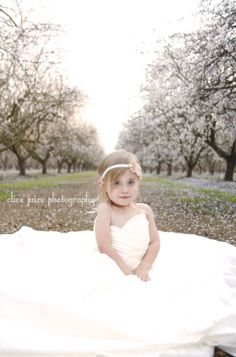 Daughter in mom's wedding dress photo shoot. mother daughter wedding dress. toddler photography, toddler posing. Olive juice photography. witharmsoutstretched.me