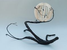 Artist: Patrick Guerin When I saw this it immediately thought of a salamander with it's tail wrapped around a japanese lantern pod