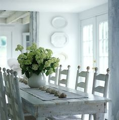 Whitewashed table and chairs with a lovely seashell table runner. The perfect seaside cottage dining room!
