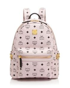 2e1a3919a926 Studded sides add just enough edge to Mcm's street-smart compact backpack  in signature logo. Bloomingdales