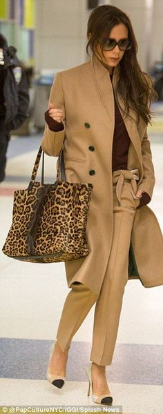 Victoria Beckham wearing camel coat & trousers from her own collections.