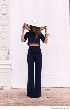 Navy suit with a very big hat