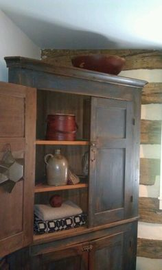 Armoires are a great catch-all for storage and fit nicely with the cabin aesthetic, too.