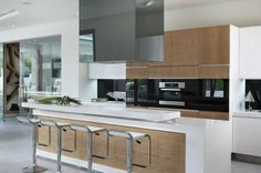 white pale blonde wood and black contemporary kitchen | Gorgeously Designed Residence in Johannesburg, South Africa