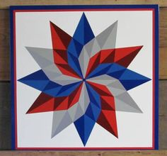 This barn quilt is the Pinwheel pattern in red, maroon, grays, metallic silver, light blue and dark blue with a white background and blue and red border. The barn quilt is painted with high gloss enamel paints on 1/2 MDO sign board which is primed with 2 coats of exterior primer. This barn quilt will look great hung on your barn, fence, shed, above your garage, next to your front door, or on your garden gate. Please allow 4-6 weeks for completion of your custom barn quilt. If you desire this…
