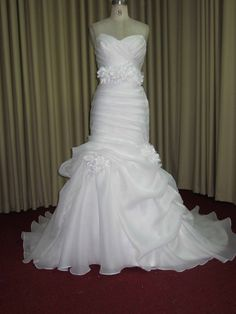 Brides can find #straplessweddingdresses with a fit-to-flare cust & style on our main website.  All bridal gowns from Darius Cordell Fashion Ltd can be made with any change and in any size.  Get pricing on custom designs and #replicas by emailing us directly.
