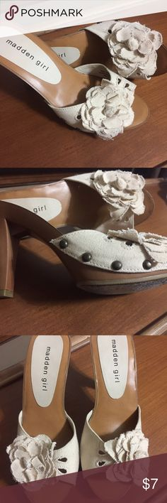 Canvas pump. With flower. Cute slide on heel. Canvas material with tack detail and flower. Rarely worn. Madden Girl Shoes Heels