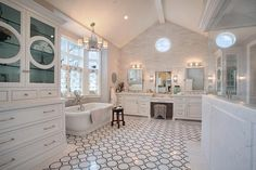 Incredible bathroom with vaulted ceilings and marble chain link pattern tiled floors.