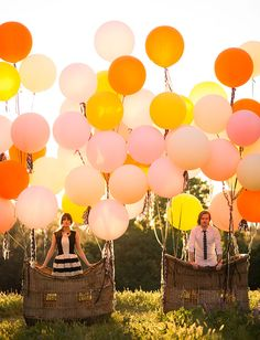 this balloon basket backdrop would make for an awesome photo spot!
