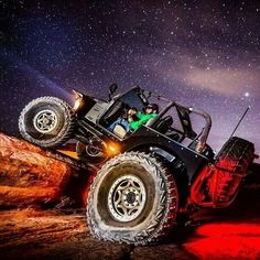 Jeep off-roading at night.