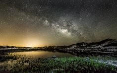 Tuesday, July 1, 2014: Astrophotographer Andrew Taber sent in a photo of the Milky Way glowing over Topsail Hill Preserve State Park in Florida, taken in May 2014. While on vacation with his family in nearby Destin, Taber made arrangements with park rangers to visit late at night to get the shot. He mentions in an email message to Space.com that he tried to include the foreground, featuring surrounding sand dunes and a pond that recently filled with water from flash floods. Light pollution…