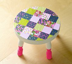 If you want to decorate a stool, try using paper and Mod Podge! This patchwork stool is easy to decoupage and looks great.