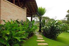 Residência SA – Ilhabela, SP: Jardins tropicais por Gil Fialho Paisagismo