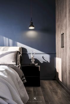 Bedroom ideas and inspiration.  Styles: Hygge. Colors: Dark colors. Features: the contrast between indigo wall and wenge closet. From apartment project: Wood-scape