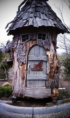 Whimsical chicken coop sitting on the corner of an industrial complex in Syosset NY.