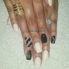 My nails. . Done by me. Nude and black w some negative space design and rose gold Swarovski crystals on my index