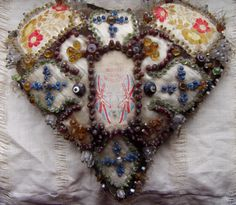 Sawdust-stuffed beaded heart: The ribbons were specially woven for soldiers and sailors for giving as gifts. Here the military ribbon forms the centre-piece of this ornate pinned and beaded heart. Military Ribbons, First Birthday Presents, Wedding Anniversary Presents, Crazy Patchwork, Crazy Quilting, Vintage Sewing Notions, Romantic Gestures, Heart Pictures, I Love Heart