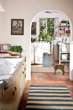 white kitchen with striped rug