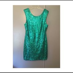 """Formal dress Bluish greenish formal dress. Worn once. Has a  v back, and zipper on the back. Is short sleeved. Fitted dress. Large would fit size 12. Sits above the knee (I'm 5' 1"""") Great for prom, weddings, etc. Has very few strings (maybe 5 at the most)  loose some strings are clear, not noticeable. Willing to accept offers. NO TRADING Dresses"""