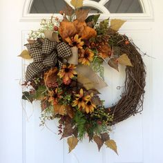 Summer Fall Wreath-Autumn Door Wreath-Farmhouse Wreath-Rustic Wreath-Country Wreath-Cottage Chic-Country Cottage Wreath-Summer Wreath This cheery farmhouse wreath is a lovely mixture of color that is perfect for the upcoming months. A natural, rustic grapevine wreath is covered with golden yellow birch leaves, sage green seeded eucalyptus, deep burgundy eucalyptus and black-eyed Susans. A mixture of autumn pip berries and mini pumpkins are tucked amongst the foliage, adding the perfect…