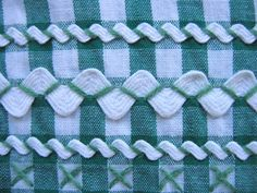 detail of vintage dark green gingham apron with white rick rack trim