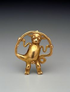Veraguas, Panama, 9th-15th century, gold:    This pendant in form of a monkey holding its tail is less than three inches in size. In some Mesoamerican cultures, the monkey is considered mysterious because it looks and acts so human-like. Because they live in trees and eat fruits and foliage, some traditions associate monkeys with vegetation the sun and sky.