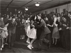 Soldiers and girls jitterbug at a National Guard service club in Hattiesburg, Mississippi, 1941. Photo by J Baylor Roberts for the National Geographic Society.