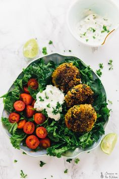These Crispy Quinoa Patties are so great for meal prep! They are made with spinach and tomatoes, are vegan and gluten free, and are served with a divine vegan yogurt tahini sauce!