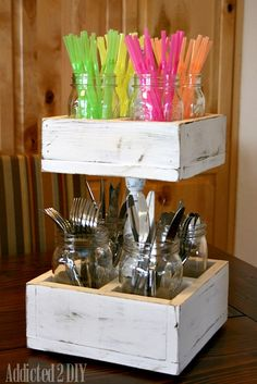 I would use this for our camper! Utensils on the bottom and condiments on the top! Double-Decker Mason Jar Craft Caddy