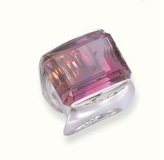 AN UNUSUAL AMETRINE AND 18K WHITE GOLD RING, BY MAUBOUSSIN   Set with a rectangular-cut ametrine to the convex heavy 18k white gold band, size 5½, with French assay marks for gold, in a Mauboussin violet leather case  Signed Mauboussin, Paris, no A 2140