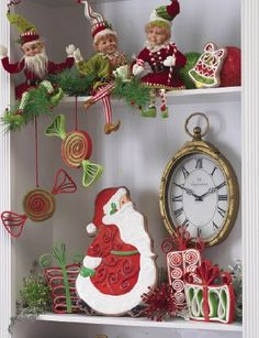 Santa Cookie on a book case with Christmas elves