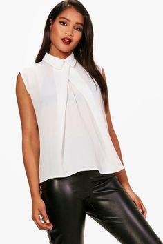 Click here to find out about the Rebecca Sleeveless Chiffon Blouse from  Boohoo, part of 60a1462071e0