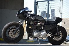 Harley-Davidson Sportster XL1200 Cafe Racer by An Bu Custom #motorcycles #caferacer #motos   caferacerpasion.com