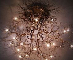 Take an interior decorating cue from Mother Nature herself by illuminating your home with this tree roots ceiling lamp. This work of art features a pewter wire design resembling an interconnected web of roots with light bulbs scattered all throughout the structure.
