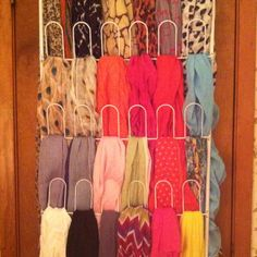 Make your own masterpiece with scarves.. An over the door shoe rack makes the perfect storage for my #1 accessory!!