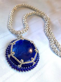 Beautiful royal blue pendant with chain maille handmade. This pendant was wrapped with bead embroidery craft. You can find this necklace in my ETsy shop  BeadsHead.Etsy.com. and purchase it for 80 $.  You are invited to visit my blog:  BeadsHead.com  or write to me  BeadsHead@gmail.com  Thanks  Orly
