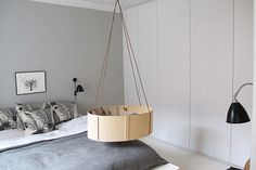Danish home tour of Mia-Louise of MisseMai Prints. Hanging baby cot or bassinet.