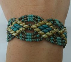 Beaded Jewelry, Bead Woven Bracelet, Super Duo Beads, Miyuki Seed Beads, Green and Turquoise, Magnetic Clasp. The ideal Gift. This extremely pretty, eye-catching bracelet is hand woven from Miyuki Seed Beads and Super Duo Beads in shades of green and turquoise. The bracelet has a