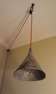 Metal Funnel Made Into A Pendant Light With Red Cloth Covered Cord And Edison Bulb