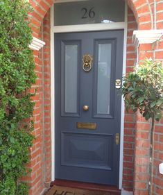 Gorgeous Victorian front door in Farrow & Ball's Downpipe with Voysey & Jones Vintage door furniture