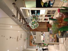 Anthropologie Regent Street store interior - beautiful display. Ladder for hanging merchandise.